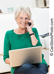 Senior lady chatting on her mobile