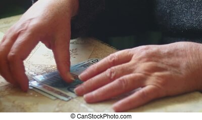 Senior lady counting euro banknotes, selective focus, very shallow DOF, very closeup shot
