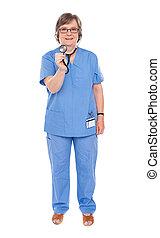 Senior lady doctor posing with stethoscope