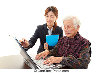 Senior lady enjoys computer