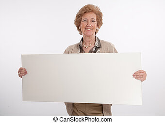 Senior lady holding a blank board