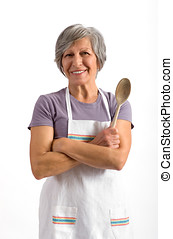 Senior lady holding a wooden spoon
