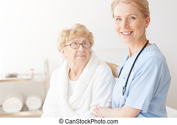 Senior lady in home with nurse