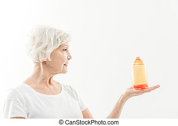 Senior lady is excited about new curative remedy