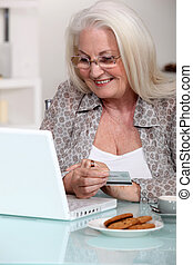 senior lady shopping on the internet