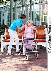 Senior lady with a care assistant or her daughter