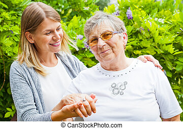 Senior lady with beautiful granddaughter - Picture of a...