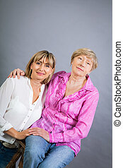 Senior lady with her middle-aged daughter