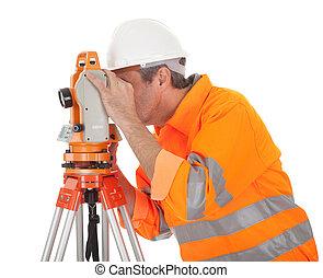 Senior land surveyor with theodolite