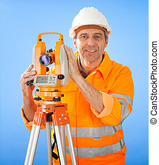Senior land surveyor with theodolite
