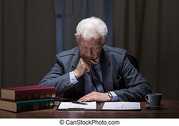 Senior lawyer working overtime
