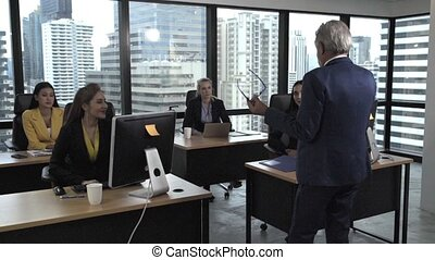 Senior leader giving advice speech to team members. Creative business people meeting at table in modern office. Multicultural business team.