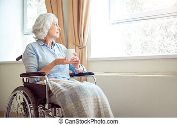 Senior lonely woman in wheelchair