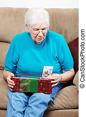 senior looking at christmas present