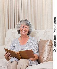Senior looking at her photo album