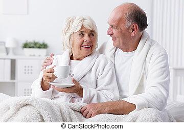 Senior lovers in bed