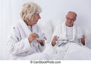 Senior lovers in bedroom