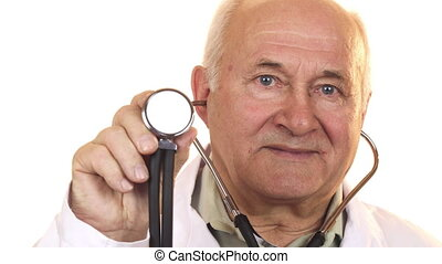 Senior male doctor holding up a stethoscope to the camera