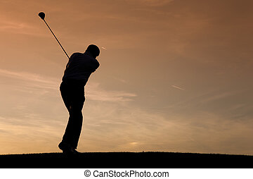 Senior male golf player at sunset