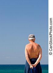 Senior male - Mature senior grandfather pensioner looking at...