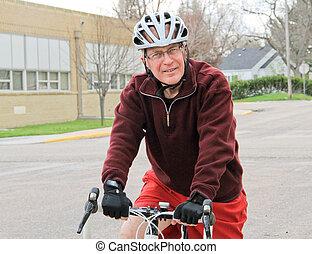 Senior male on racing bike 3