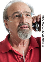 Senior male with breathing disability talking on the phone