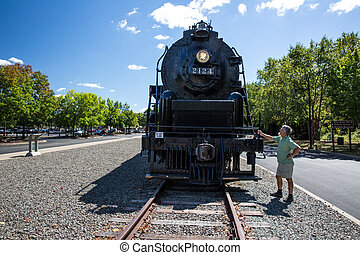 Senior man admiring the Union Pacific Big Boy Steam Locomotive X4012 in Scranton, PA