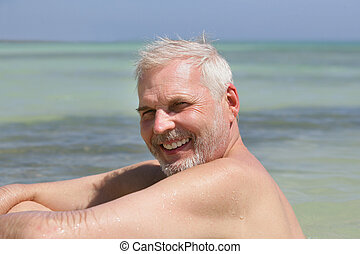 Senior man alone at the beach