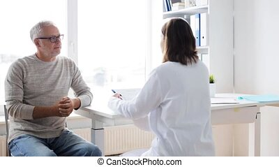 senior man and doctor meeting at hospital 33 - medicine,...