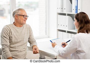senior man and doctor meeting at hospital