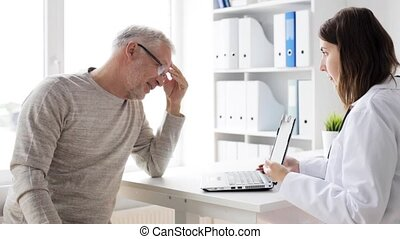 senior man and doctor with tablet pc at hospital 70