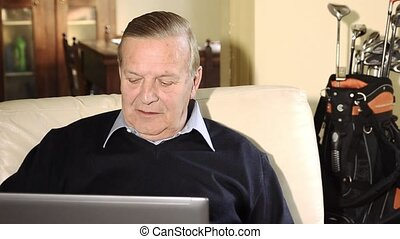 senior man and notebook - Senior businessman working at home