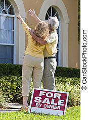 Senior Man and Woman Couple Viewing A House For Sale