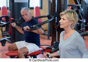 senior man and woman during gymnastic