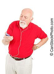 Senior Man Annoyed by MP3 Player