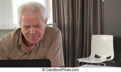 Senior man asking advice from his grandson