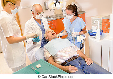 Senior man at dentist surgery have treatment