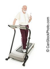Senior Man at Health Club - Senior man on the treadmill...