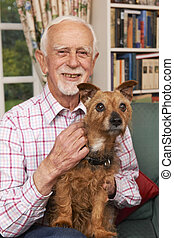 Senior Man At Home With Pet Dog