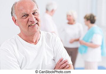 Senior man at the gym