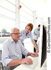 Senior man attending business training