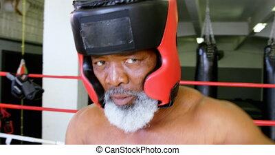 Senior man boxing in the fitness studio 4k