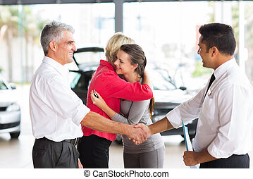 senior man buying a new car for his daughter