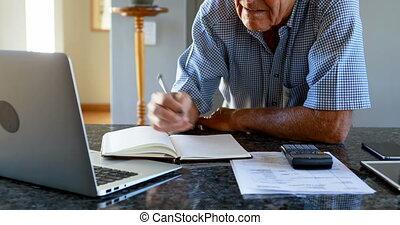 Senior man calculating budget of household 4k