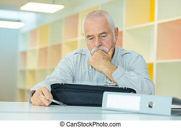 senior man checking his papers