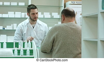 Senior man coming to drugstore to buy tablets or pills....