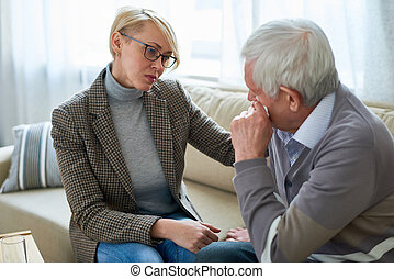 Senior Man Crying in Therapy Session
