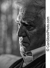 Senior man crying - Black and white portrait of senior man...