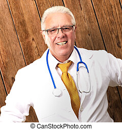 Senior Man Doctor With Hand On Hip