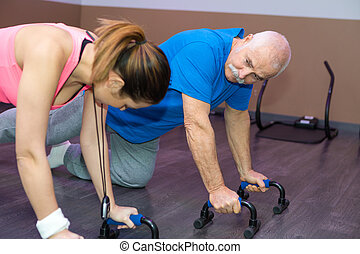senior man doing crossfit in a fitness club